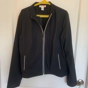 Black and white track jacket. Size: XL